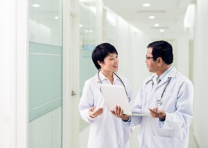 two international doctors discussing patient in the hall